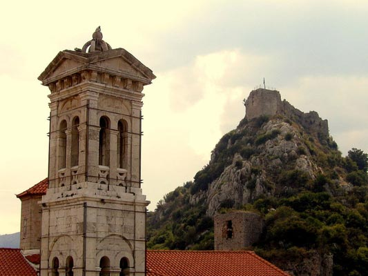 Platrithias, Ithaca, Ithaca Island Belltower with the Karytaina Castle in the background  photo by  Roman Klementschitz, wikipedia.org