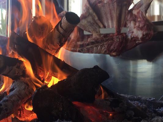 Antikristo lamb slow roasted on olive wood, Chania restaurant, Crete.